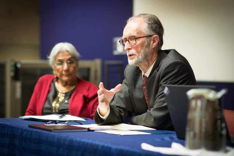 "Bahá'í representative (right) and Alia Hogben (left), director of the Canadian Council of Muslim Women, in a panel discussion at the ""Our Whole Society: Bridging the Religious-Secular Divide"" conference, held 22-24 March 2015 at the University of British Columbia in Vancouver, Canada"