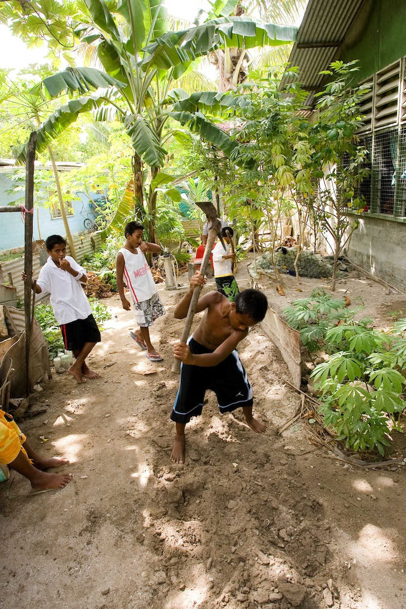 A group of youth making a garden as part of a service project for their Junior Youth Spiritual Empowerment Program in South Tarawa, Kiribati