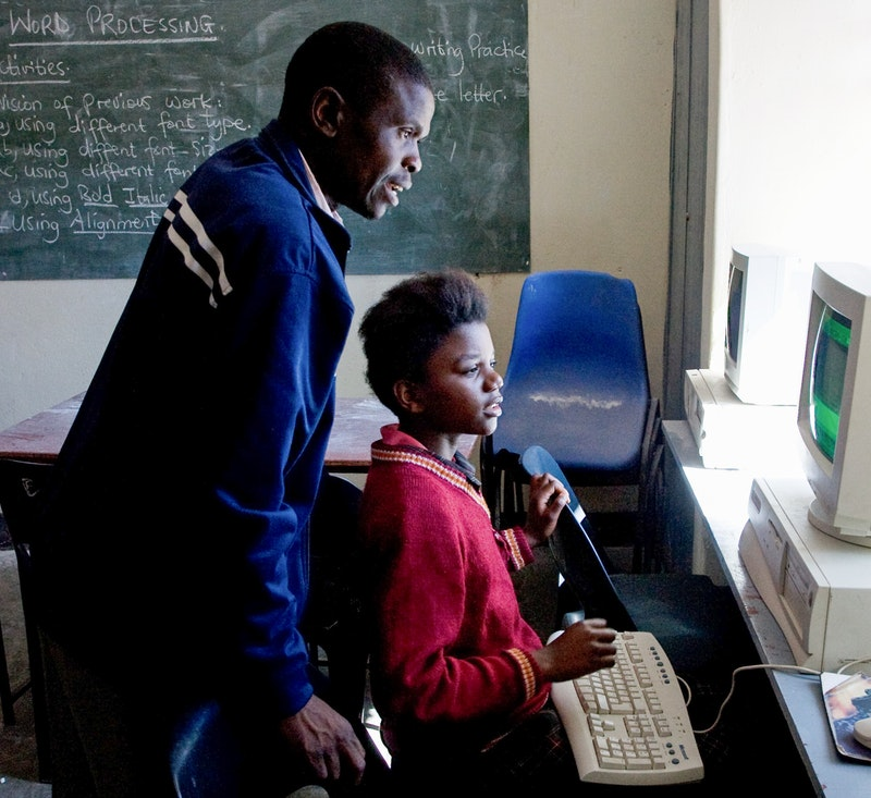 A computer lesson at Bambino School, a Bahá'í-inspired school in Lilongwe, Malawi
