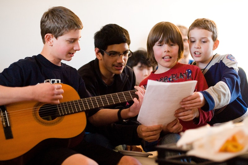 A group performing music as part of their study of the spiritual empowerment of junior youth in Vancouver, Canada