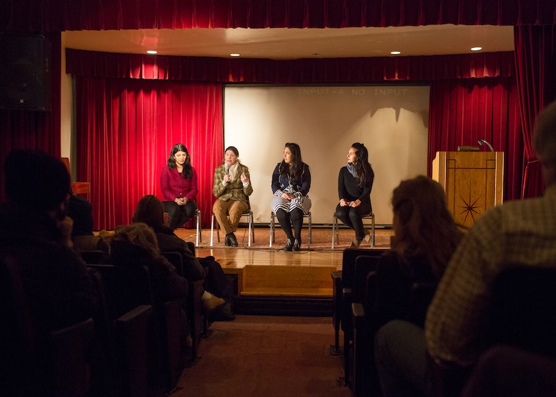 "A panel discussion at an event called ""Education Under Fire"" co-sponsored by the Baha'i Community of New York City and Amnesty International"