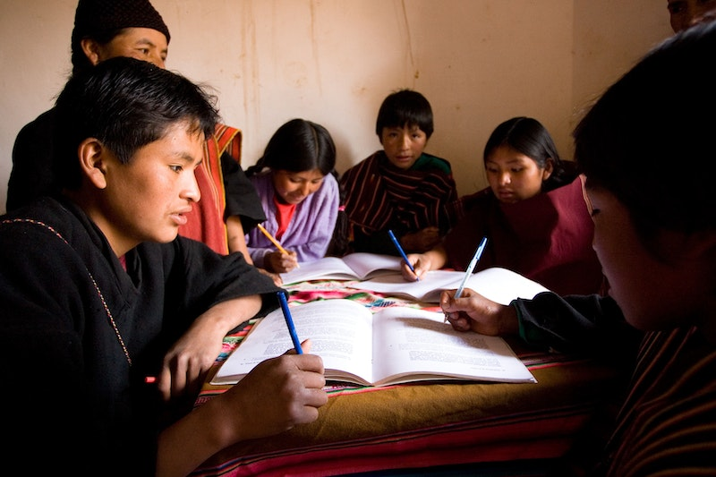 A group studying the spiritual empowerment of junior youth in Tarabuco, Bolivia