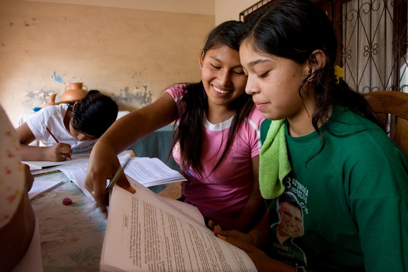 A group studying the spiritual empowerment of junior youth at the Baha'i centre in Montero, Bolivia