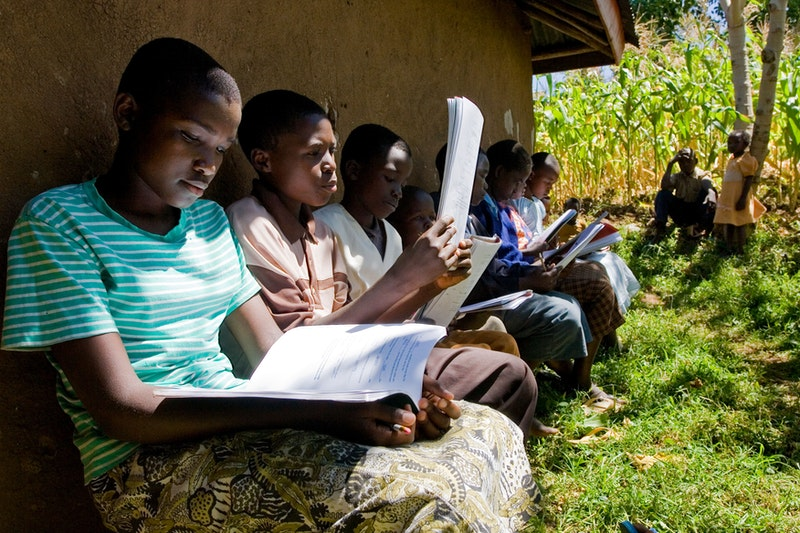 A group studying the spiritual empowerment of junior youth in Triki West,