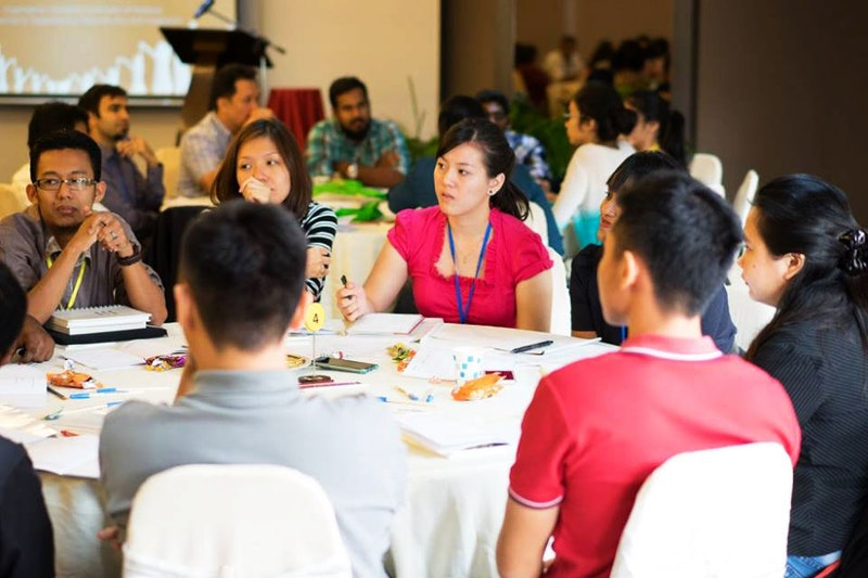 Attendees participate in a roundtable discussion at the recent conference on the
