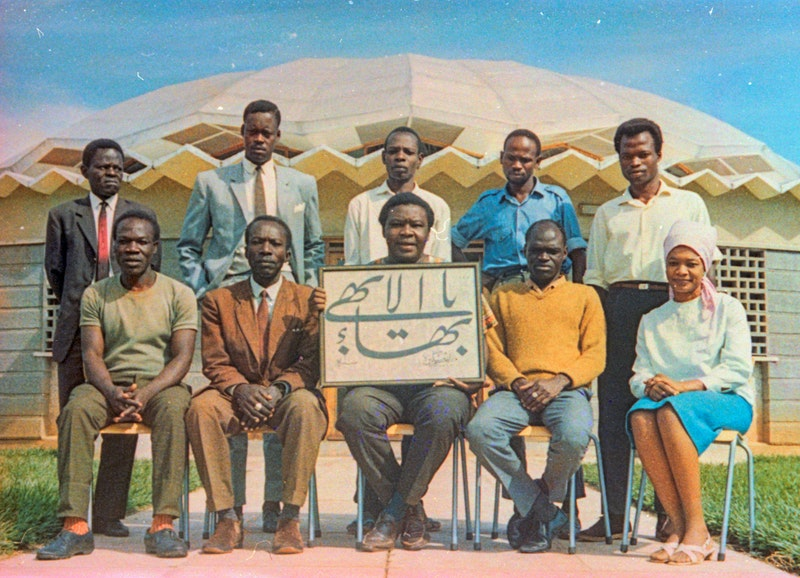 National Spiritual Assembly of the Bahá'ís of Uganda and Central Africa with Hand