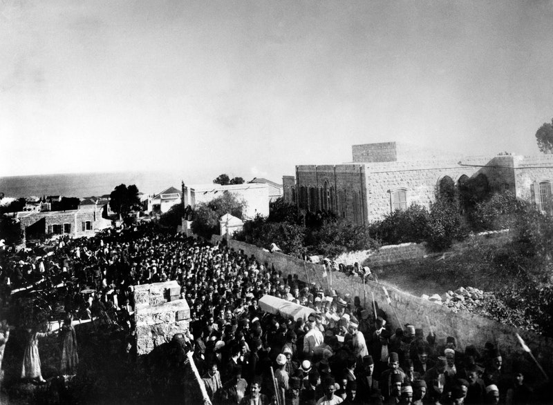 Ten thousand mourners from numerous religious backgrounds attend the funeral of 'Abdu'l-Bahá in Haifa, 29 November 1921