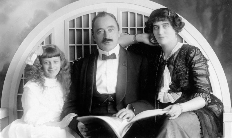 The first Baha'is of Switzerland, Dr. Joseph de Bons and his wife, Edith de Bons, with their daughter, Mona, in 1911.