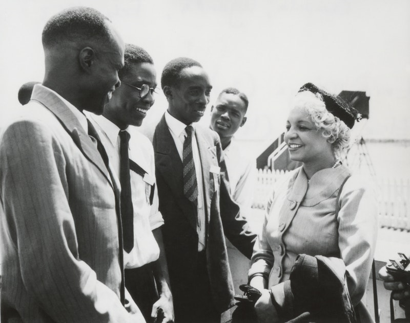 Elsie Austin (right) and Enoch Olinga (second from left) at the International