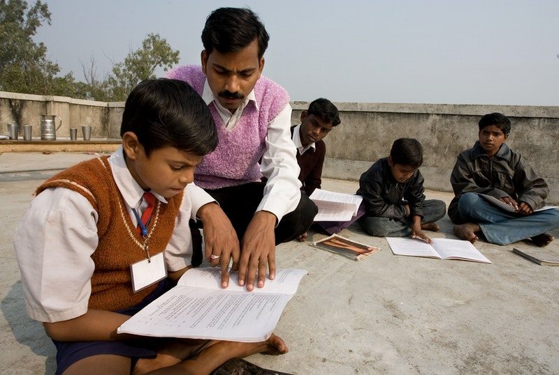 A group studying the spiritual empowerment of junior youth in Biharsharif,