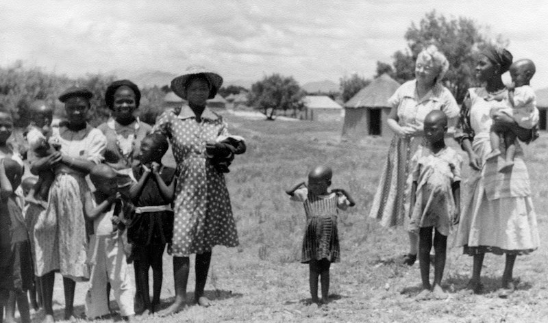 Elizabeth Laws, known as Mother of Love, with local people in Lesotho. They arrived