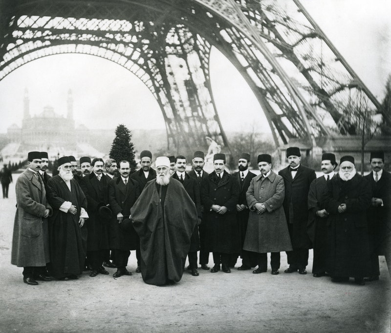 'Abdu'l-Bahá with a group of Bahá'ís under the Eiffel Tower in Paris, France,
