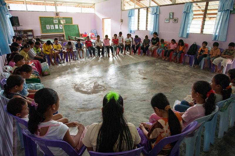 Children gathering for prayers after their Children's Classes at the Baha'i Centre
