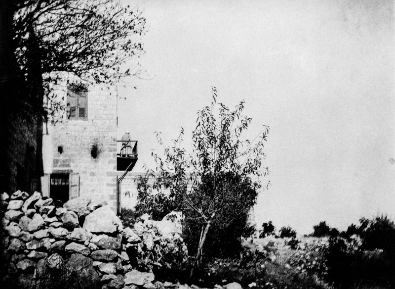 'Abdu'l-Bahá standing on the balcony of the house of Abbas Gholi, c.