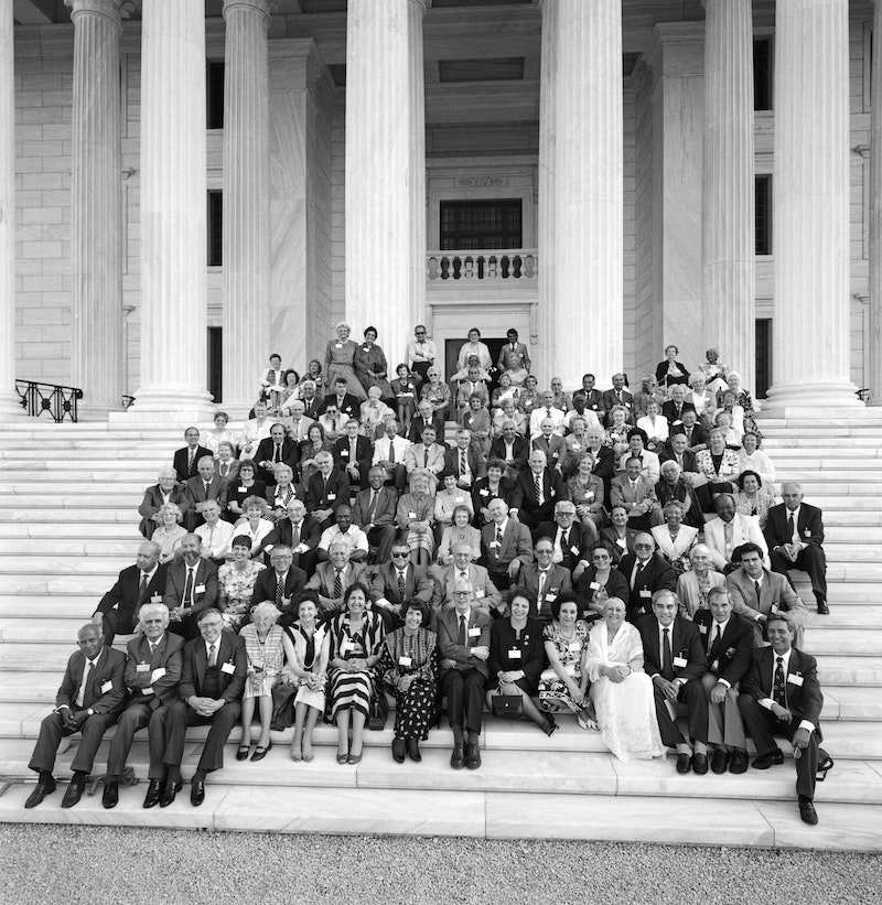 Knights of Bahá'u'lláh gathed on the steps of the Seat of the Universal House of
